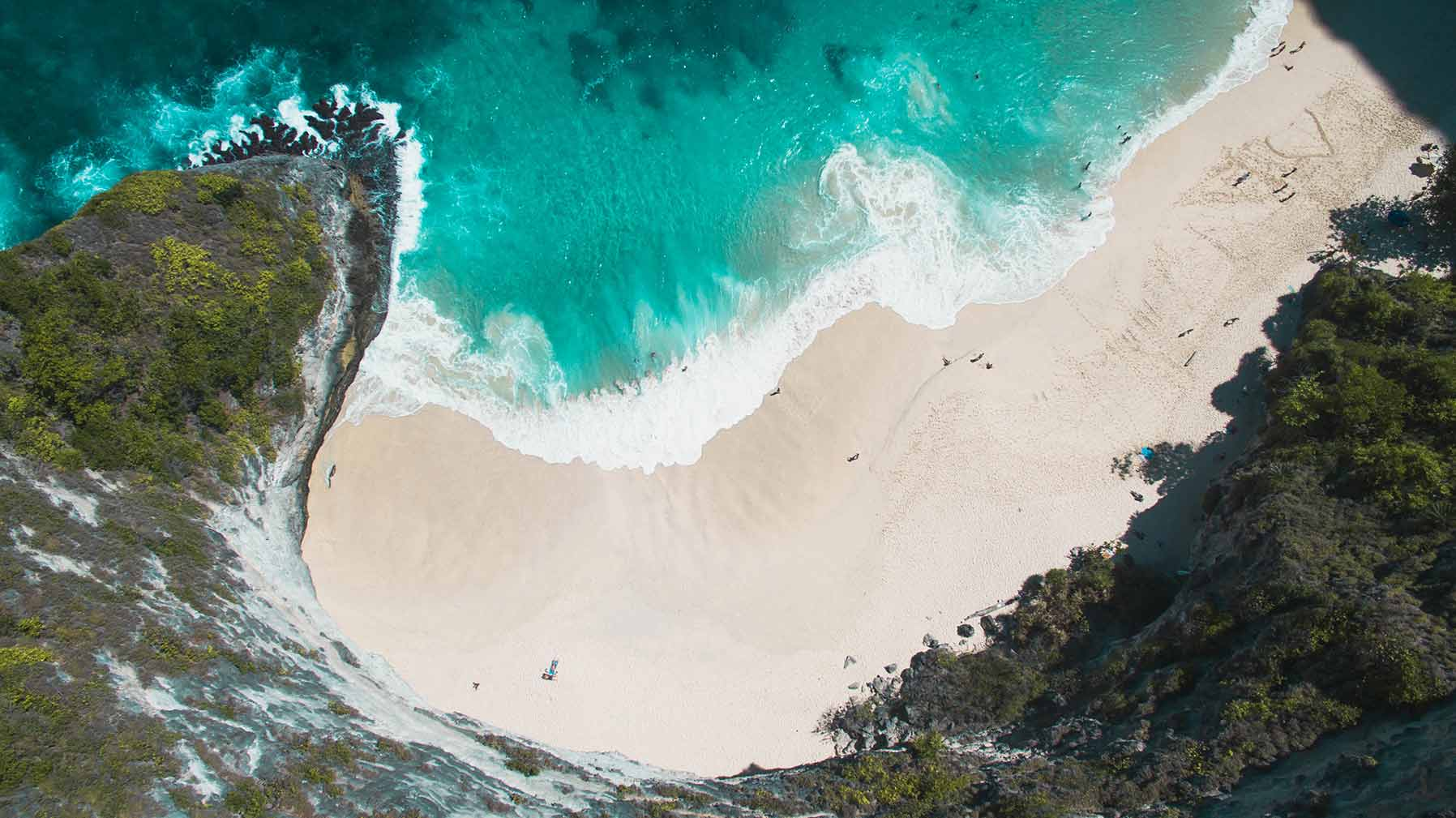 kelingking beach nusa penida drone shot above beach