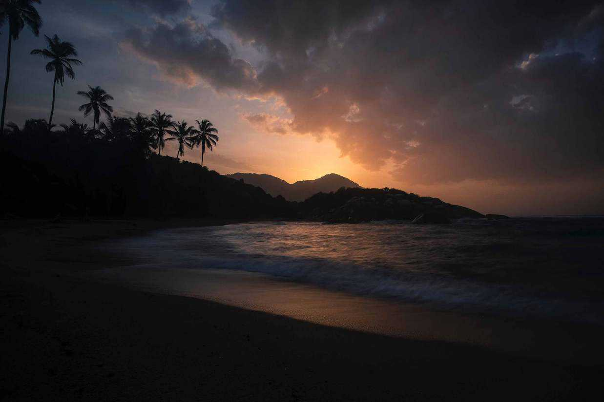 visiting tayrona national park colombia sunset